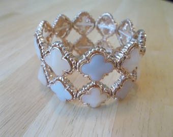 Gold Tone Stretch Cuff Bracelet with Ivory and Pail Blue Beads