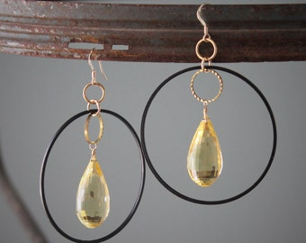 Kelly Earrings: Huge lemon quartz briolettes dangle with gold and black hoops; 14k gold filled ear wire