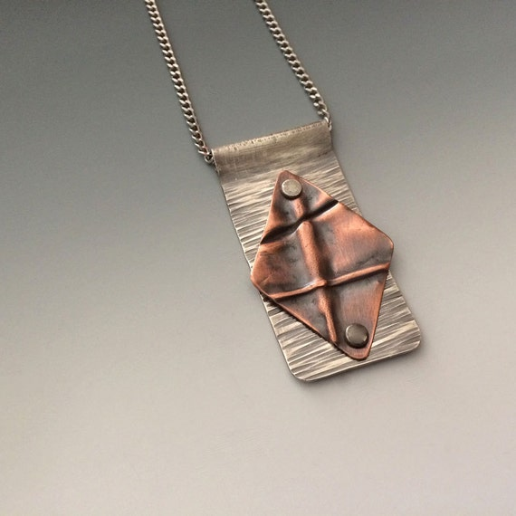 Fold formed silver and copper diamond shaped cold connected pendant