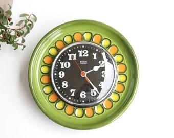 EMES Electronic ceramic wall clock, green orange yellow flower, 1960s