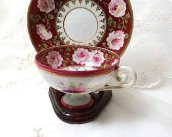 Vintage Tea Cup and Saucer, Pink Roses on Maroon with Green Foliage