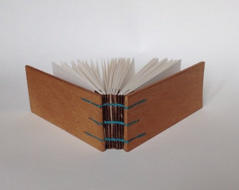 Cigarbox notebook, artbook in coptic binding, old cigar box book with blanco pages