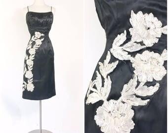 Vtg 50s black satin pinup wiggle cocktail dress / raffia straw embroidered flowers / rhinestones / gathered shelf bust / metal zipper