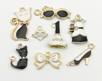 8 charms collection gold tone and enamel,11mm to 27mm  #ENSA 240