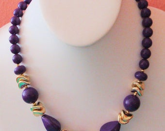 Purple beads with gold tone spacers