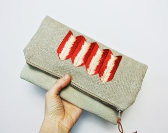 Fold over clutch with hand embroidered detail / Suede and linen