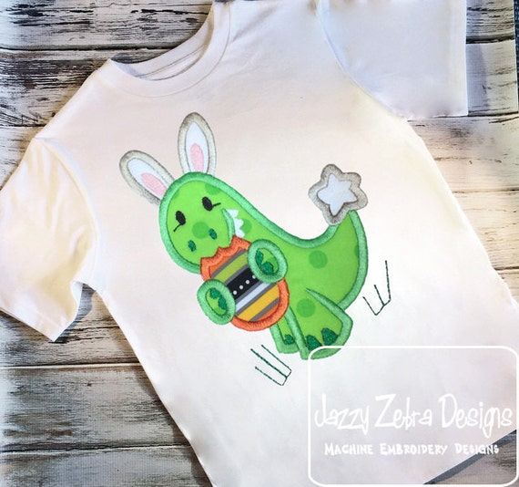 Dinosaur wearing bunny ears and eating Easter Egg appliqué design - Easter appliqué design - dinosaur appliqué design - dino appliqué design