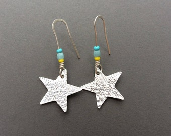 Small star handmade earrings with recycled glass bead