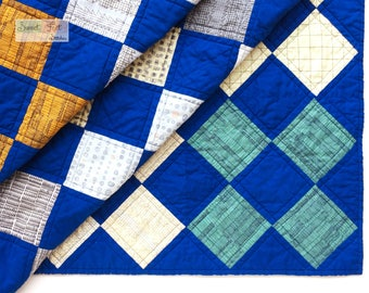 Bright Modern Child's Quilt in Orange, Gold, Gray, White, & Blues