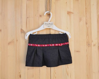 Jeans sirt with little red stitched ribbon and a bow