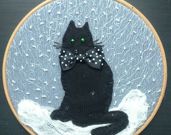 Black cat in the snow ,fabric collage and embroidery in a hoop
