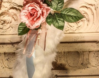 White faux fur stocking with pink rose