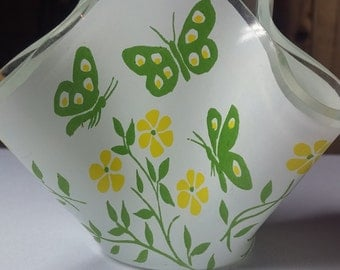 vase with green butterflies and yellow flowers