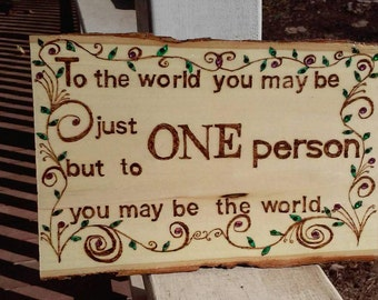 """Wood burned plaque with the inspirational quote """"To the world..."""" decorated with leaves and vines, painted and embellished with crystals"""