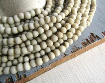 Small round cream beige  lampwork glass bead, rustic opaque semi matte , irregular roundish spacer Indonesian 3 to 5mm / 20 in strand 6CB9-1
