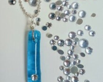 Recycled glass necklace made from fused Cabo Wabo bottle and crystal.