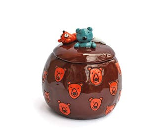 Sweets bowl with emerging teddy bears