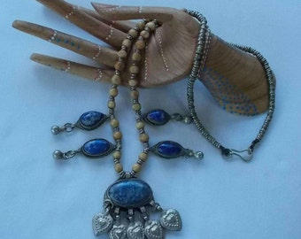 Silver tone necklace with tan beads, blue agate stones and heart dangles.  (443