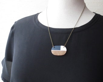 Meid - Oval Modernist Graphic Color Block Necklace; Handmade Hand-painted Clay Ceramic Navy, Cream and Brass Mod Print Pendant by InfinEight