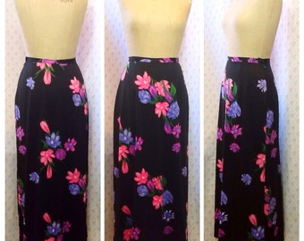 Wonderful Vintage 1970's black polyester nylon jersey pinka and purple floral printed maxi skirt.