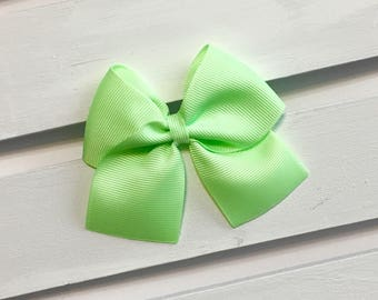 Light green clip in hair bow, green hair bow, green hair bows, little girl hair bows, hair bow, alligator clip hair bows, ribbon bows