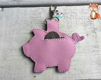 Piggy bank quarter keeper keychain.