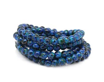 140 beads in Breeze blue and black 6 mm glass