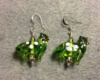 Translucent olive green with white spots lampwork cat bead earrings adorned with olive green Czech glass beads.
