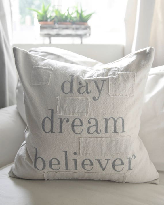 day dream believer grain sack style pillow cover. available in 16x16, 18x18, 20x20, 16x24 and 16x26. available with or without patches