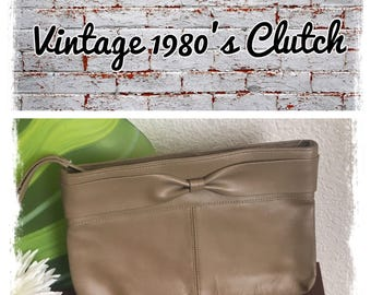Vintage 1980's tan leather bow clutch