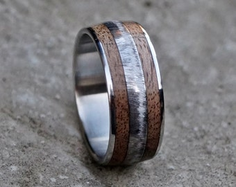 Stainless steel and walnut wood ring.