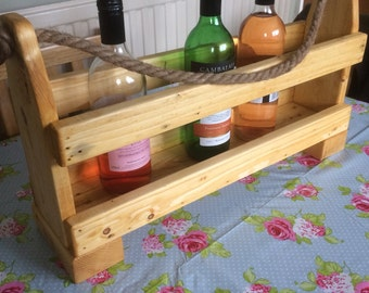 Wine rack. Free standing wine holder with handles. 57 x 15 cms