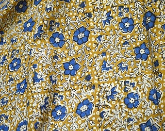 Block Print Cotton Fabric Sewing, Crafting, costume fabric sold by the yard in grey, black, blue on white background.