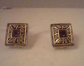 Vintage clip on earrings with purple stone at center