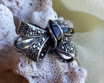Sterling silver black onyx and marcasite bow ring, size 7