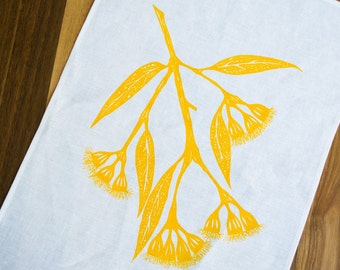 100% white linen Tea Towel screen printed with Yellow Gum Blossom design. Australian native design kitchen dish cloth / home decor.