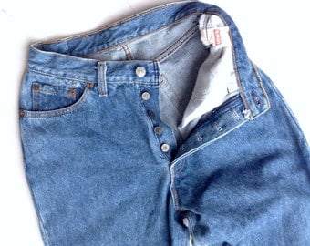 Vintage mom jeans. 80's Levis, super highwaisted, slim fit, button front, faded wash 100% cotton boyfriend jeans. W24 L29. Made in USA
