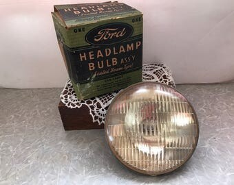 Vintage 1940 Ford head lamp bulb ass'y (sealed beam type) and original box. #730