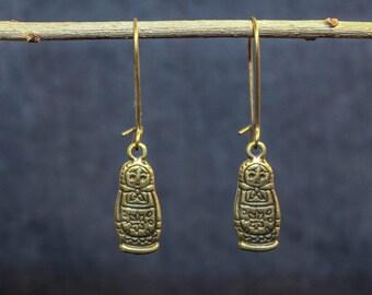 Sweet earrings with matryoshka in bronze
