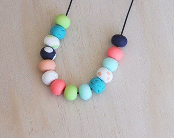 """Polymer clay bead necklace. Mint, coral, navy, white, peach texture. """"The hop"""""""
