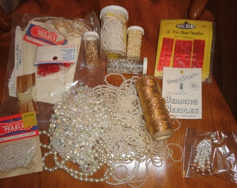 Lot of craft items,pearls,needles,thread,gold cord. Red and silver beads. ex used cond