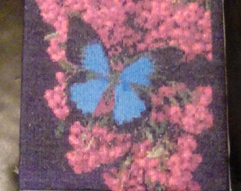 Butterfly on Berries completed cross stitch