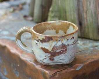 Hand-built mug with texture and creamy white glaze.  Great for espresso.