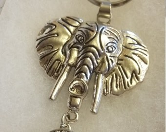 Silver colored elephant with dangle key chain
