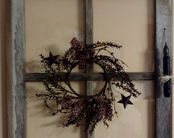 Old barn window, decorated Primitive style.