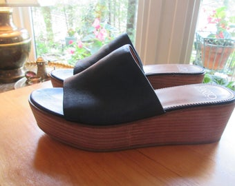Navy blue leather  stacked platform heel wedge shoe.Franco Sarto size 8 1/2 M. Soft navy leather slip on wedge sandal.