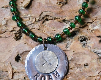 Roam Stamped Copper Pendant on Green Beaded Necklace