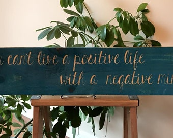 You Can't Live A Positive Life With A Negative Mind sign