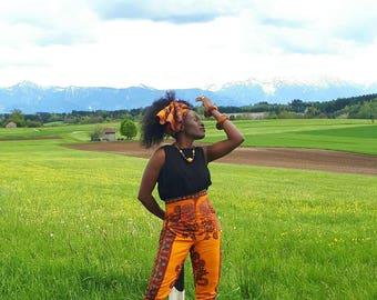 Nguissi - Elegant African print high waist trousers.