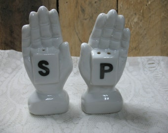 Vintage salt pepper shakers porcelain in the shape of left and right hand